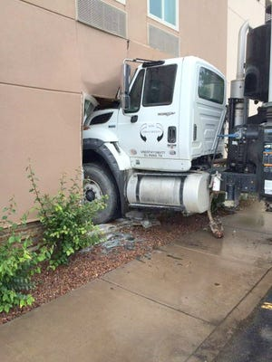 A 2013 International utility truck rolled into the Holiday Inn Express on Wednesday afternoon.