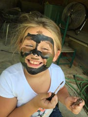 Face painting was a popular event for the kids.