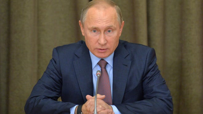 Russian President Vladimir Putin heads a meeting on military industry issues in the Black Sea resort of Sochi, Russia, on Nov. 15.