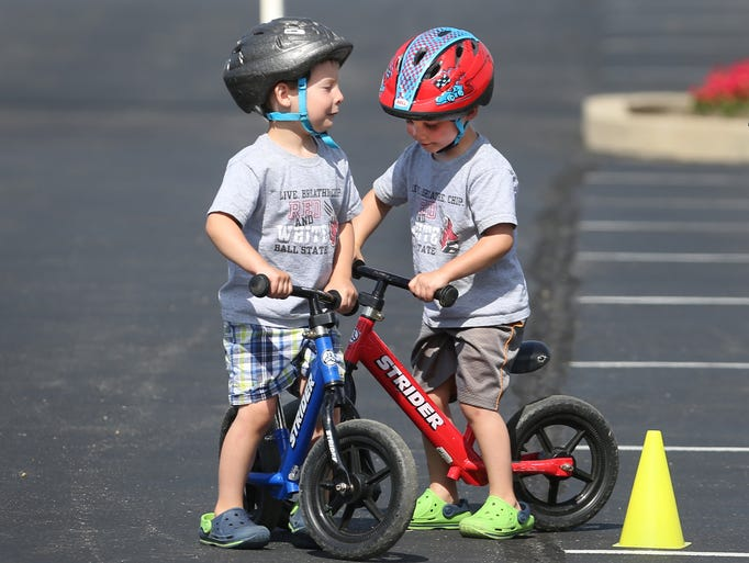 Brayden Head, 4, Westfield, left, and his twin brother Charley pause on an obstacle course of cones set up in the parking lot at Quaker Park in Westfield where the Parks and Recreation Department celebrated National Trails Day with the first-ever Bicycle Rodeo on Saturday, June 7, 2014.