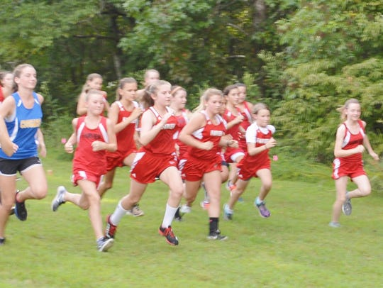 The FMS girls running for another cross country win.