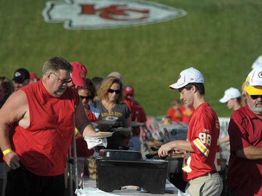 FILE - In this July 27, 2014, file photo, Kansas City Chiefs season-ticket holders line up for pancakes before the NFL football team's training camp in St. Joseph. Mo. By making fans feel as though they're part of the team, and offering gifts and experiences exclusive to members, the Chiefs have managed to expand their season ticket sales at a time when many franchises are having a hard time filling their stadiums. (AP Photo/St. Joseph News-Press, Todd Weddle, File)
