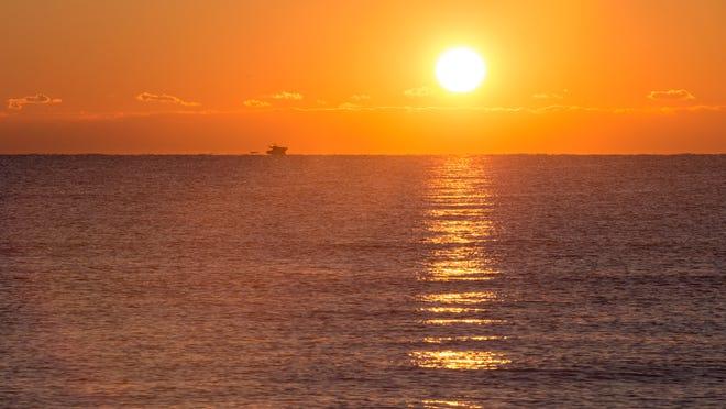 The sun rises at Assateague Island National Seashore in late October.