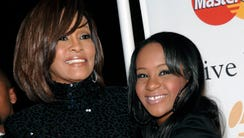 FILE - In this Feb. 12, 2011, file photo, singer Whitney