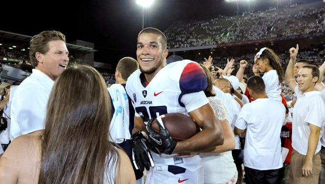 Arizona Wildcats wide receiver Austin Hill (29) celebrates after scoring the winning touchdown at the end of the fourth quarter against the California Golden Bears at Arizona Stadium.