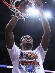 Michael Snaer cuts down the net after securing FSU's