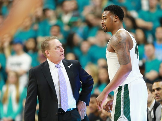 Tom Izzo talks to Nick Ward during a game against Wisconsin at Breslin Center on Jan. 26, 2018 in East Lansing.