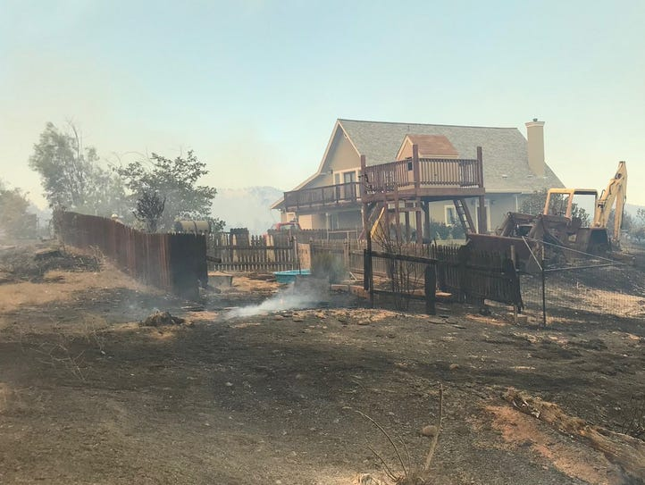 The Creek Fire burned right up to several homes along