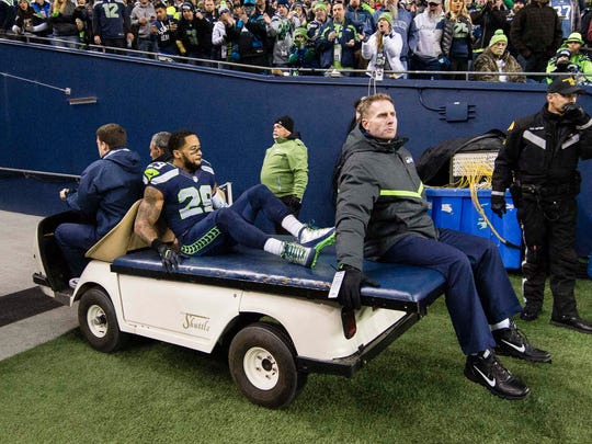 Seahawks safety Earl Thomas was taken off the field after suffering an injury against the Carolina Panthers at CenturyLink Field in December.