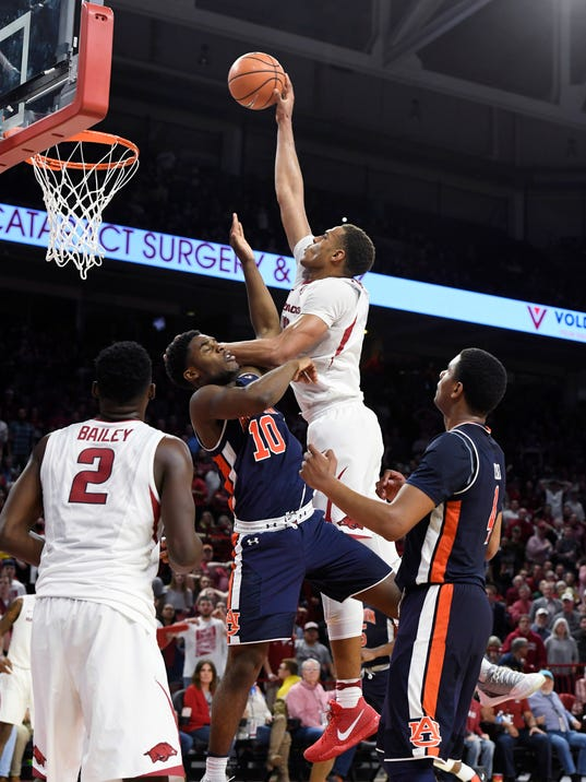 Arkansas forward Daniel Gafford tries to drive past Auburn defender Davion Mitchell during the second half of an NCAA college basketball game Tuesday, Feb. 27, 2018, in Fayetteville, Ark. (AP Photo/Michael Woods)