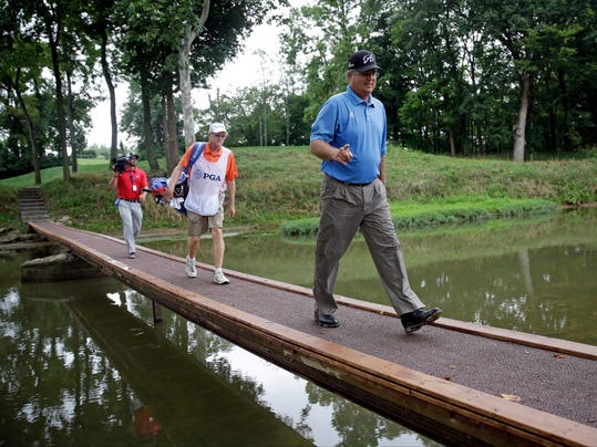 Kenny Perry walks across the bridge on the ninth hole during the third round of the PGA Championship golf tournament at Valhalla Golf Club on Saturday, Aug. 9, 2014, in Louisville, Ky. (AP Photo/David J. Phillip)