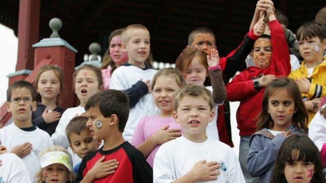 Children recite the Pledge of Allegiance in this 2010 file photo in Bradley Beach, N.J.