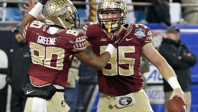 Florida State tight end Nick O'Leary (35) celebrates his touchdown against Georgia Tech with wide receiver Rashad Greene during the Atlantic Coast Conference championship game on Dec. 6.