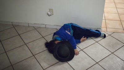 02/28/12 One of the 4 year old cries while mother has been investigated by CPS case workers.