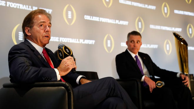 Alabama head coach Nick Saban speaks as Washington coach Chris Petersen looks on at right during a news conference Thursday, Dec. 8, 2016, in Atlanta. Alabama and Washington will face off in the Peach Bowl football game. (AP Photo/John Bazemore)