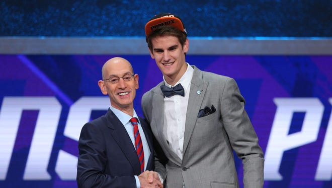 Dragan Bender (right) greets NBA commissioner Adam Silver after being selected as the number four overall pick to the Phoenix Suns in the first round of the 2016 NBA Draft at Barclays Center.