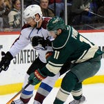 Minnesota's Zach Parise, right, made a surprisingly quick return to the lineup.