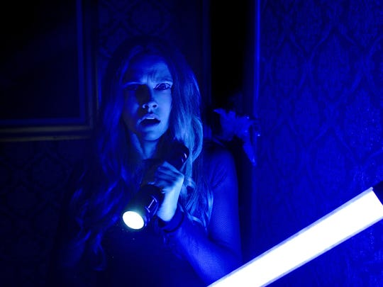 """Sophie (Maria Bello) sees something in the dark in """"Lights Out."""""""