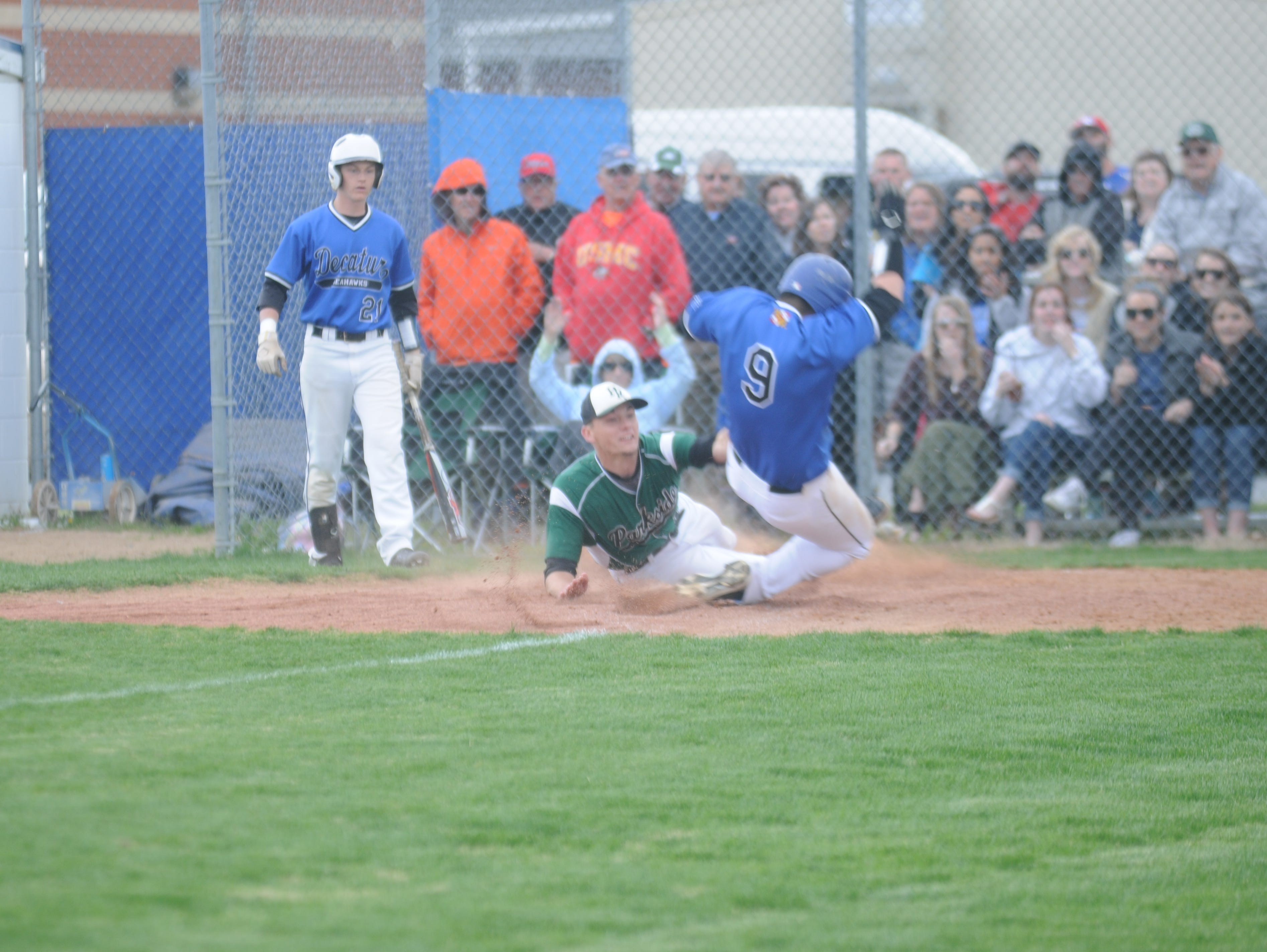 Parkside pitcher Hunter Parsons tags out Decatur's Sean Colgan after a passed ball. The play kept Parkside in the lead 1-0 at the time.