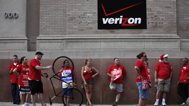 In this Aug. 8, 2011 file photo, Verizon workers picket outside one of the company's central offices in Philadelphia. About 39,000 Verizon landline and cable workers in nine eastern states including Pennsylvania and Washington, D.C., walked off the job Wednesday morning after little progress in negotiations since their contract expired nearly eight months ago.