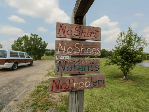 Handmade signs are seen at the entrance to Cherry Lane