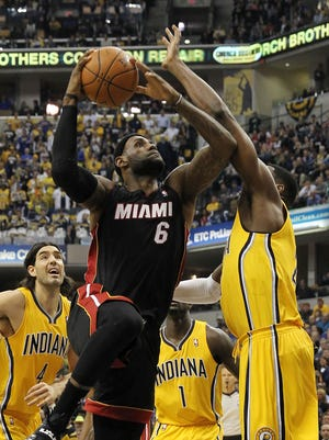Miami forward LeBron James goes up for two of his game-high 38 points, but it wasn't enough as Indianapolis holds off the Heat, 84-83.