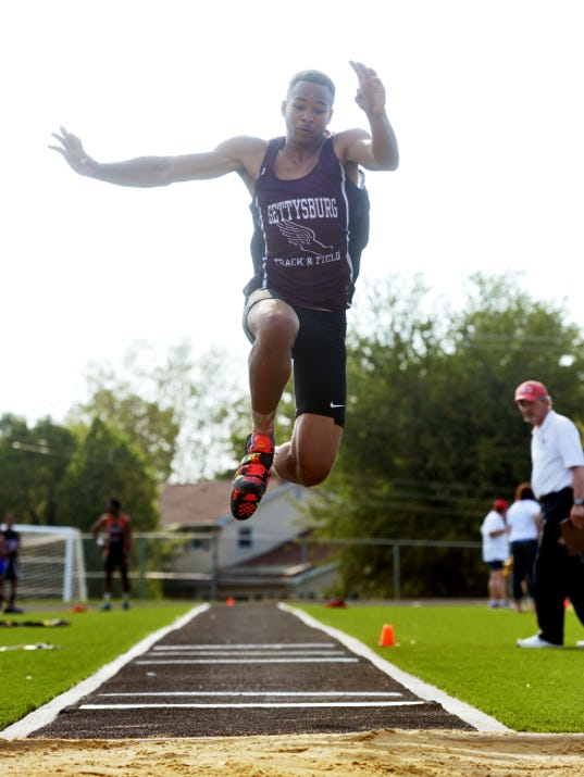 Gettysburg's Ravaughn Dillard competes in the triple jump at the YAIAA track and field championships Friday at Dallastown High School. In its first season as a YAIAA member, Gettysburg watched as Dillard cleared 47 feet, 1 inches in the triple jump to win the event.