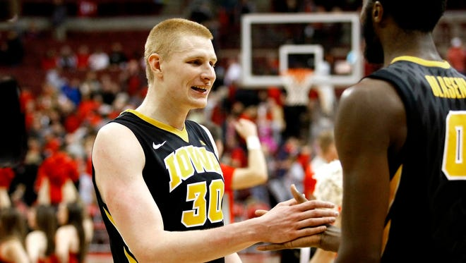 Iowa Hawkeyes forward Aaron White (30) celebrates following a 71-65 win over the Ohio State Buckeyes at Value City Arena.
