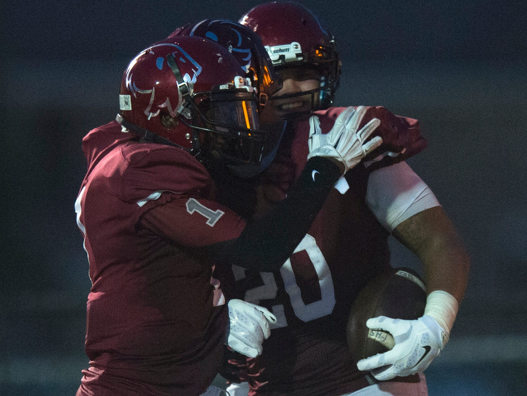 Prattville's Kingston Davis celebrates with DeKeith Whatley after scoring a touchdown during the game on Friday, Sept. 4, 2015 in Prattville, Ala.