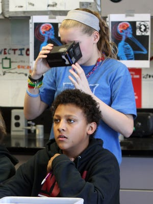 Nyack Middle School seventh-graders Karl Rodriguez and Jenna Davidson work on a fake news and virtual reality project March 29, 2017.