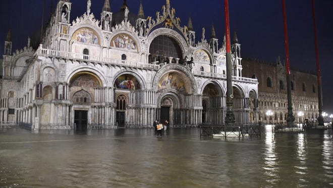 A view of flooded St. Mark square in Venice, Italy, Thursday night, June 4, 2020. Venice has been submerged by a near-record high tide that is rare for this time of year. The water level in the lagoon city reached 116 centimeters late Thursday, the third-highest mark for June. That level indicates around a quarter of Venice has been flooded.