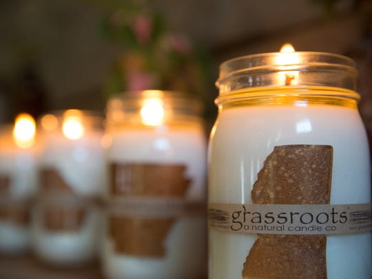 """Grassroots Natural Candle Company's containers are all reusable and recyclable, and the only part of the product """"that doesn't grow out of the ground is the jar,"""" according to the Columbus, Miss., company's Web site."""