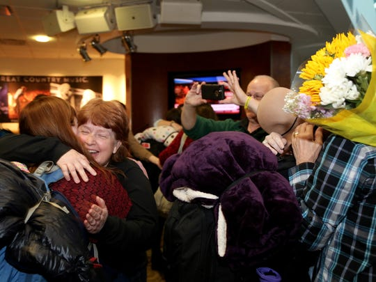 Families greet Freed-Hardeman students returning from their study abroad trip Tuesday evening at Nashville International Airport.