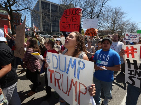 Protesters march to the Mid-Hudson Civic Center as people gather inside for a Donald Trump rally on Sunday in Poughkeepsie.