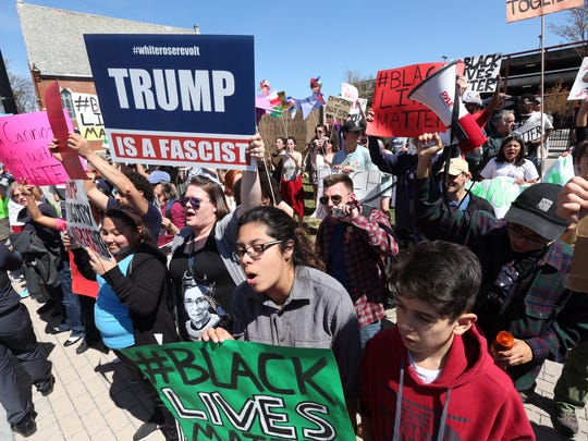 Protesters chant anti-Trump slogans in front of the Mid-Hudson Civic Center as people gather inside for a Donald Trump rally on Sunday.