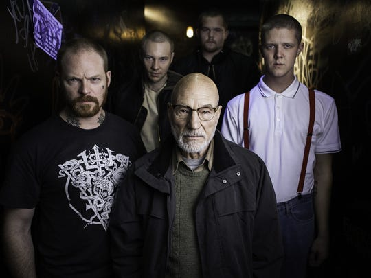 "Patrick Stewart, center, is the villain in the thriller ""The Green Room."""