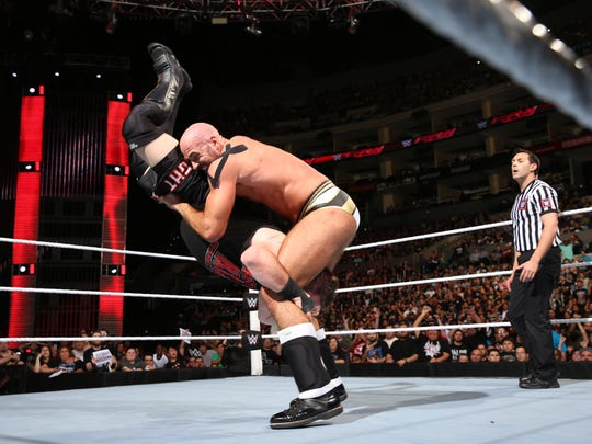 Cesaro performs his finishing move, the Neutralizer.