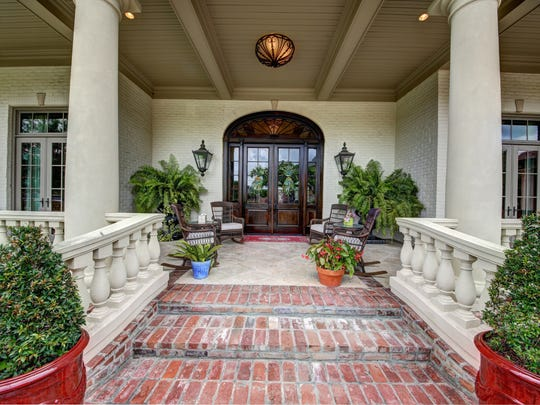 This grand home sits on three lots in River ranch overlooking