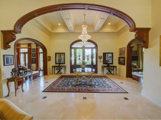 The beautiful foyer is a grand introduction to the home.