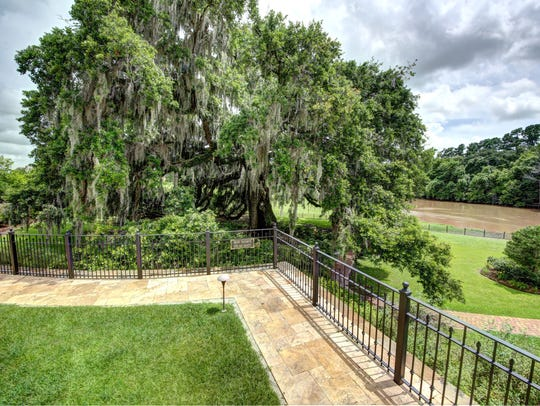 This estate sits on three riverfront lots in River