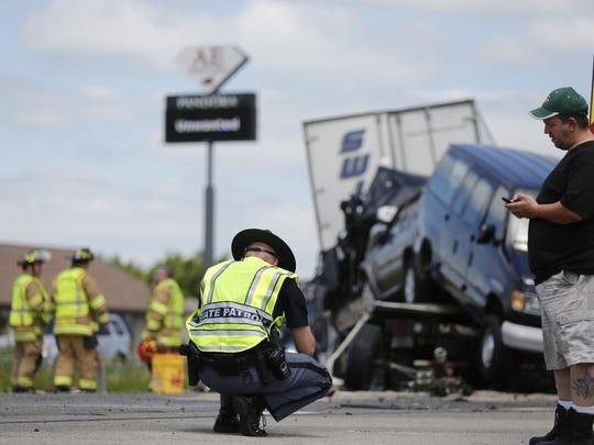 A state patrol officer investigates the fatal crash