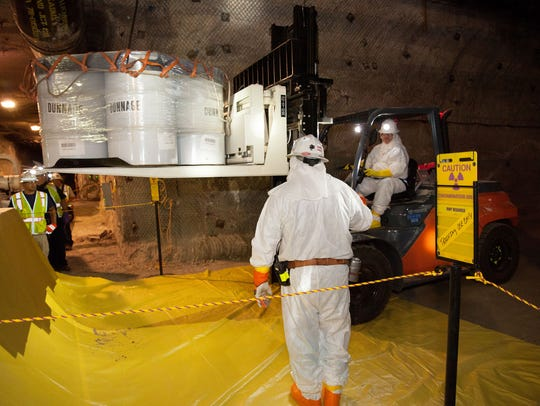Waste handlers and radiation control technicians take