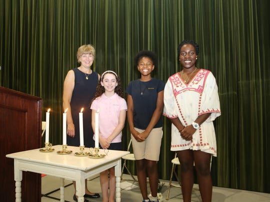 Kent Place Head of School Sue Bosland, Ava Zinna of Madison, Aya Mtume of Orange and Babi Oloko of Berkeley Heights