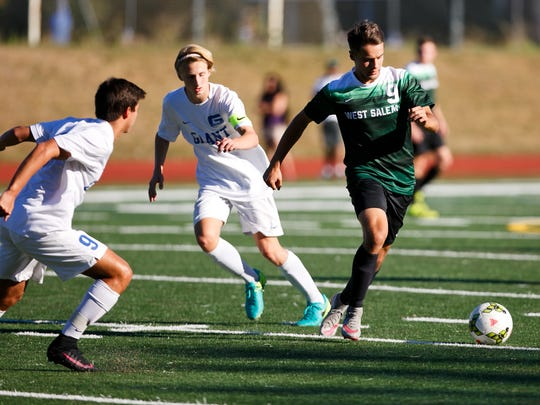 West Salem's Stuart Aeschliman (9) controls the ball in a game against Grant High School on Tuesday, Sept. 13, 2016, in Portland, Ore. The West Salem Titans tied 1-1 with Grant.