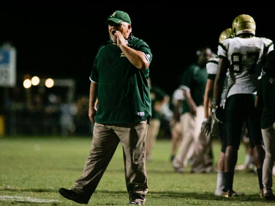 Acadiana head coach Ted Davidson shouts from the sideline near the end of the Rams' game against Carencro Sept. 16, 2016 in Carencro.