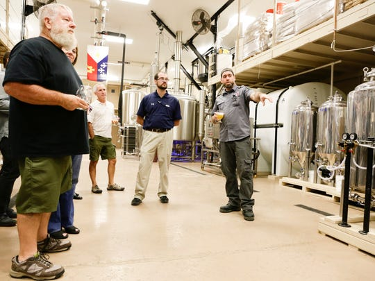 Master brewer James Lutgring leads a brewery tour during the grand opening of the tap room at Cajun Brewing in Lafayette Sept. 29, 2016 .