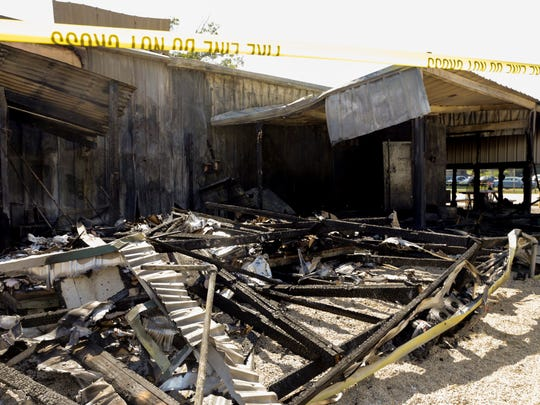 The burned remnants of Don's Specialty Meats, following a devastating fire, in Carencro Oct. 3, 2016.