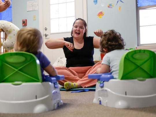 Kira Deforest sings with children at Creative Learning Preschool in Lafayette on Friday.