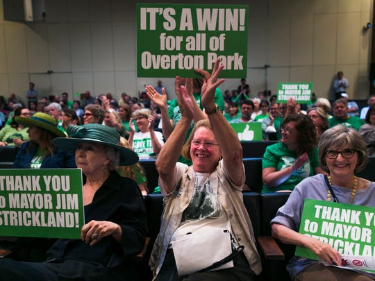 July 19, 2016 - Community activist Mary Wilder claps while sitting next to fellow Greensward supporters: former senator Beverly Marrero, left, and Emily Carothers, right, during a City Council meeting on Tuesday. Members of the City Council voted unanimously for a plan to end parking on the Overton Park greensward. (Yalonda M. James/The Commercial Appeal)
