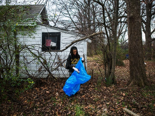 """Alden Taylor, 11, picks up trash near a house on Ash St. during a Memphis Kings and Clean Memphis cleanup in the Douglass neighborhood on Saturday morning, Feb. 18, 2017. The organizations teamed up to shine a positive light on young African-American teens in Memphis. """"Everyday we get new opportunities to teach kids what community is about,"""" said Sam Davis, CEO and founder of Memphis Kings Youth Organization. """"I tell everybody I meet, you know, in order to change the world the only thing you got to do is change your world. Change the world you live in and you will be changing the world."""""""